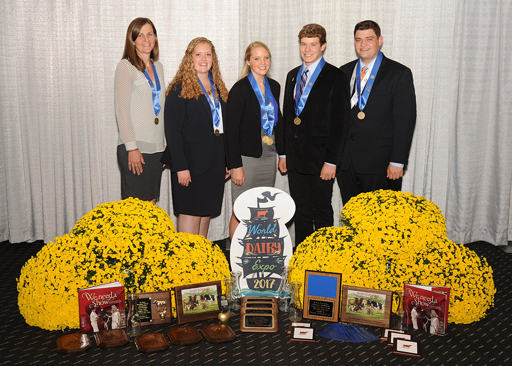 members of the dairy judging team pose with their awards from the World Dairy Expo