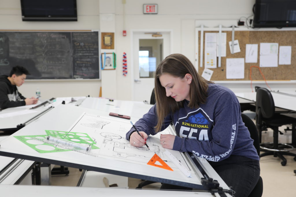Student on Drawing Board