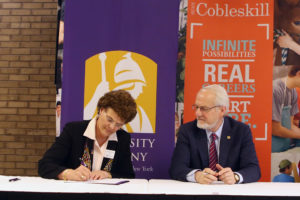 SUNY Cobleskill President Marion Terenzio and University at Albany Interim President James Stellar sign 33 new articulation agreements on Tuesday, May 2 at SUNY Cobleskill.