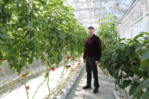 Instructor Bob Sutherland in one of SUNY Cobleskill's greenhouses in 2015.